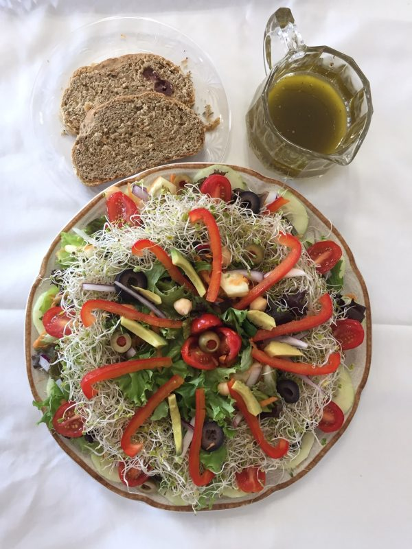 Salad with sprouts and toast